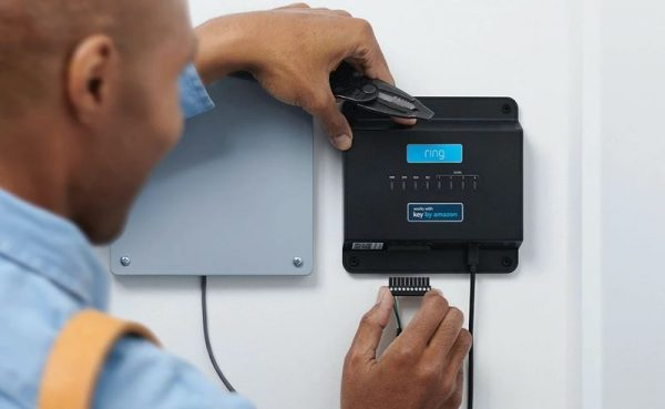 a black man installing a security alarm system