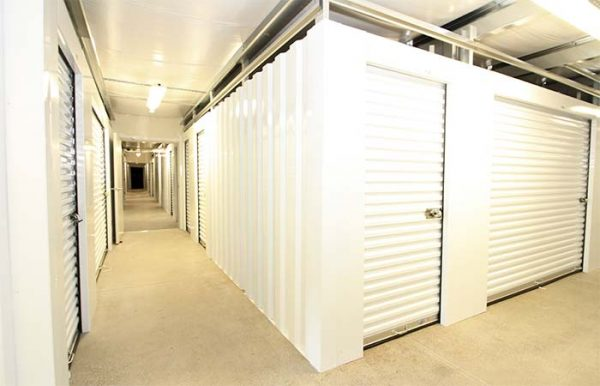 a spacious storage facility with white storage units