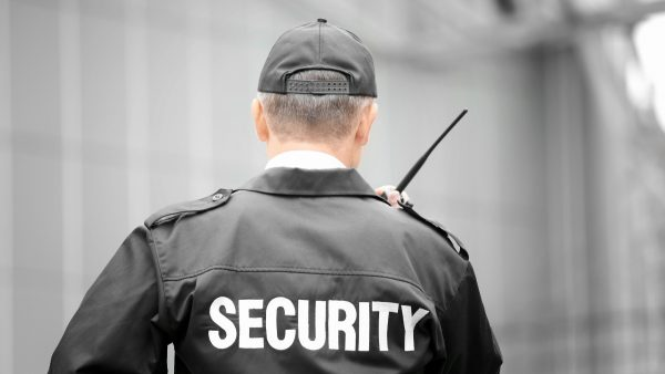 a security officer talking on a two-way radio