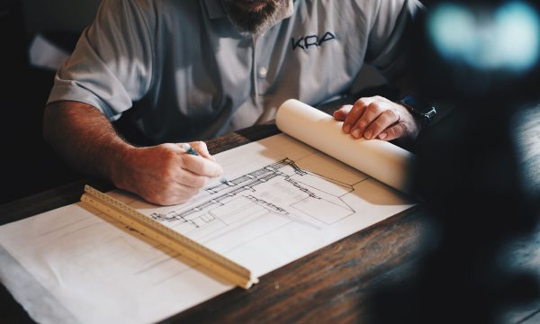 a man sketching a site map for his business